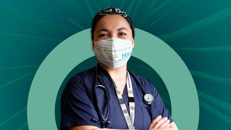 Nurse with mask standing in front of digital backdoor with flu campaign branding