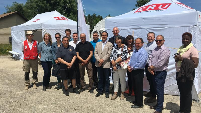 Representatives from Cree Nation of Chisasibi, Cree Health Board, and Red Cross stand in front of Emergency Response Unit equipment