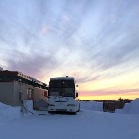 Photo of Clara Bus parked in Wemindji during a sunset in winter